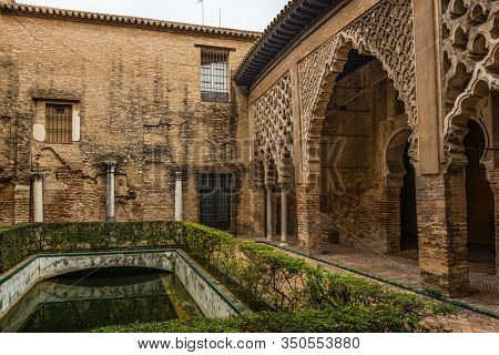 SEVILLE, SPAIN - December 09 2019: Patio del Yeso courtyard with its Almohad Moorish architecture in the Real Alcazar, Seville, Spain