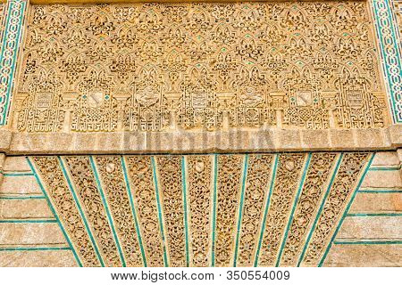 SEVILLE, SPAIN - December 09 2019: Detail of carved relief ornamentation at Real Alcazar in Seville, Spain showing intricate Moorish designs in close up