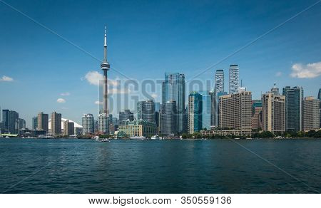 Toronto Skyline With Scyscrapers And Lake Ontario On Beautiful Sunny Day As Seen From Toronto Island