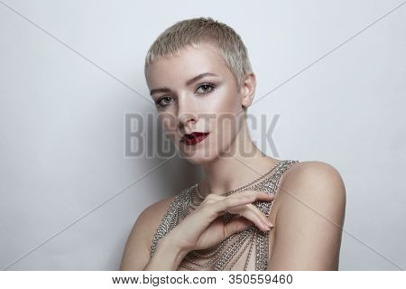 Beautiful woman with short haircut and wine red lipstick