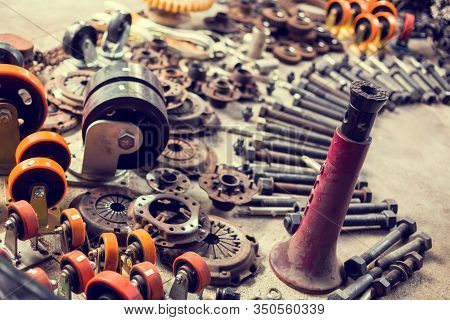 Many Tools And Old Auto Spare Parts Car At A Car Repair Shop. Car Parts In Old Warehouses.