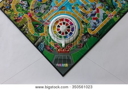Orlando, Fl/usa-2/12/20:  Game Of Life By Hasbro With A Car Stopped At The Family Spot Having A Baby