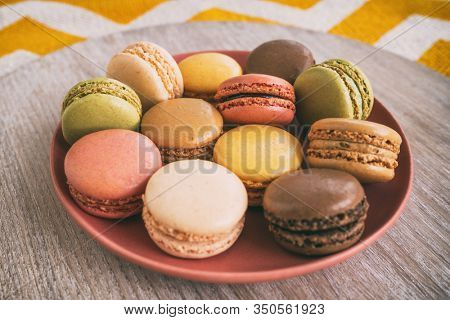 Macarons on plate retro home style.