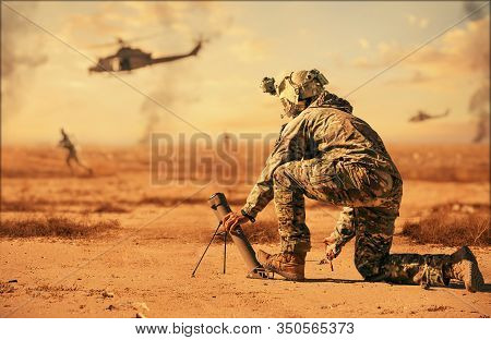 Military Troops And Helicopter On The Way To The Battlefield In Desert