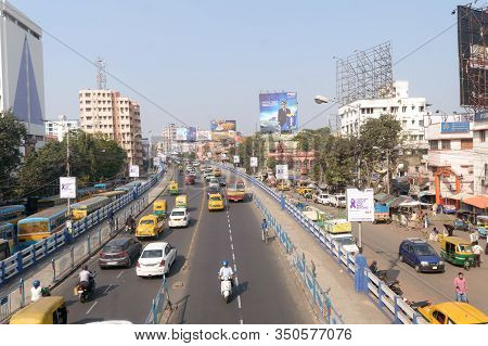 Traffic And Pedestrians On Crowded City Streets In Evening Rush Hour On Dhakuria Bridge Flyover One