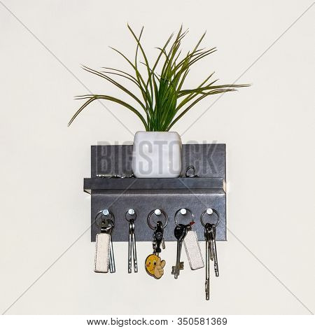 Keys Hanging On Wooden Key Holder Mounted On Wall