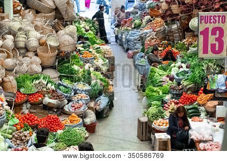 SUCRE / BOLIVIA - APRIL 10, 2018: Interior of the local market in the city of Sucre in Bolivia full of vegetables and hand made goods
