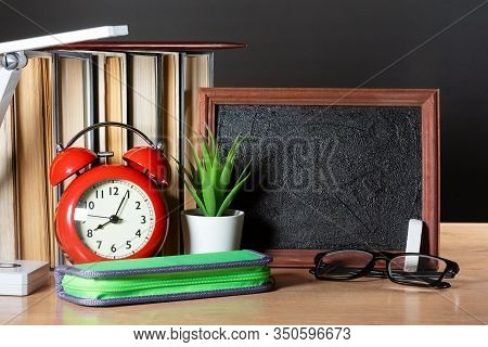 Education Concept Background With Copy Space. Empty Blackboard And School Accessories On School Desk