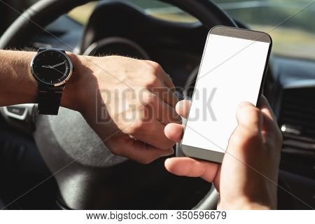 Driver Is Looking On A Blank Screen Mobile Phone With Copy Space And Is Checking A Time On His Wrist