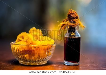 Close Up Of Glass Cup Full Of Raw Jaggery Or Gud Or Palm Jaggery And Its Extracted Oil In A Glass Bo