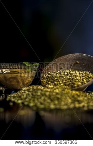 Close Shot Of Mung Bean Or Moong Dal In A Clay Bowl Along With Some Water And Moong Dal Well Mixed O