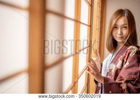 Lovely Asian Girl Wearing Yukata Japanese Tradditional Cloth In Traddition Japan Style  In Tatami Ro