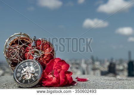 Fruit In The Heart Gift Box, A Pocket Watch And Red Rose With A Sky Background As A Symbol Time For