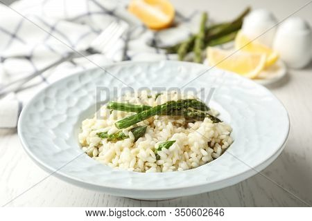 Delicious Risotto With Asparagus On White Wooden Table, Closeup