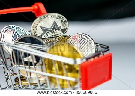 Bitcoin And Altcoins Coin In A Shopping Cart On A White Background