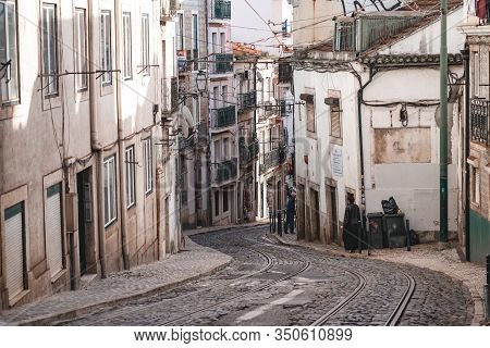 Lisbon, Portugal - January 17, 2020: Typical Urban Street Scene, With Cobblestone Streets, Streetcar