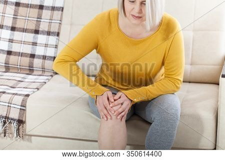Middle-aged Woman Suffering From Pain In Leg At Home, Closeup. Physical Injury Concept. Ankle Pain,