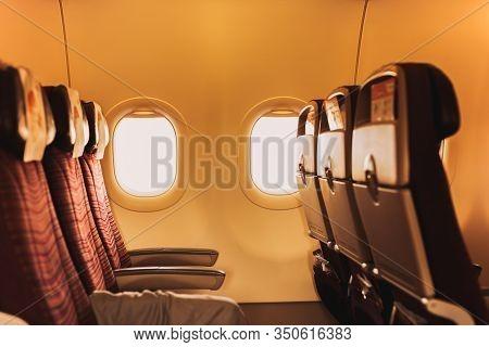 Empty Airplane Passenger Seats Next To Window In Economy Class.