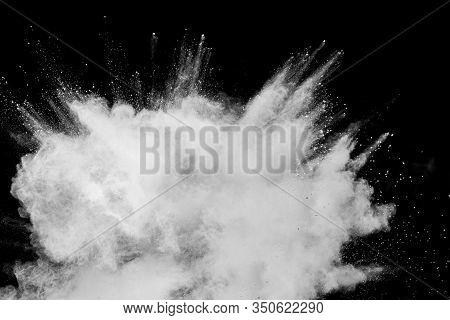 Abstract White Powder Explosion.white Dust Debris On Black Background.