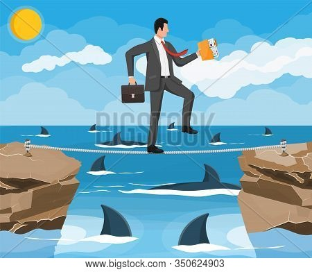 Businessman Walking A Tightrope Over Shark In Water. Businessman In Suit Walking On Rope With Briefc