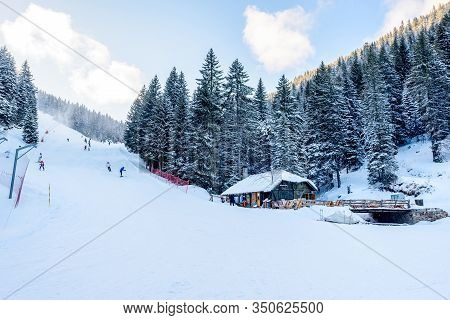 Kopaonik, Serbia - January 30, 2020: Skiers And Snowboarders On A Ski Piste In Kopaonik Ski Resort,