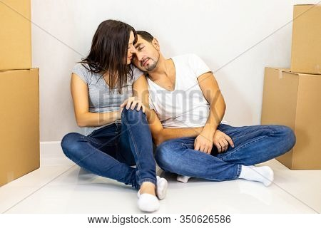 Young Tired Couple Feeling Fatigue On Long Hard Moving Out Day, Exhausted Restless Man Sleeping On W
