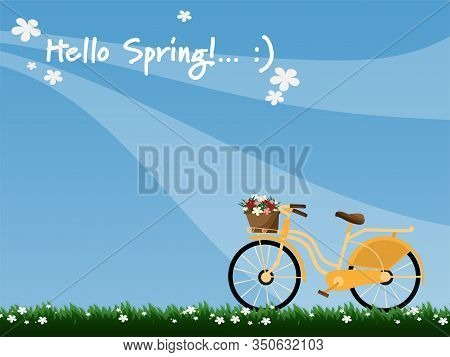 A Yellow Bicycle With Wicker Basket Full Of Spring Flowers Viewed From The Side And Hello Spring Tex