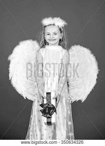 Angel Child From Heaven Gives You Gift. Cute Toddler Girl In White Wings As Cupid. Angel Kid With Bl