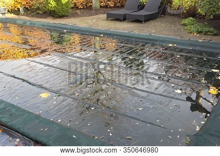Garden Swimming Pool With Swimming Sail In The Autumn, Protection Ready For Winter Needs Cleaning Fo