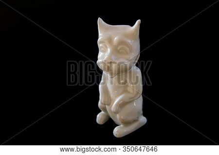 An Odd  Figure Of Porcelain In The Shape Of A Sitting Dog