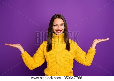 Photo Of Cheerful Positive Cute Attractive Woman Holding Two Things With Hands Smile Toothy Holding