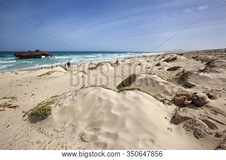 Beautiful Sand Dunes Landscape With Tourists On Tour Viewing A Shipwreck On Boa Vista In Cape Verde