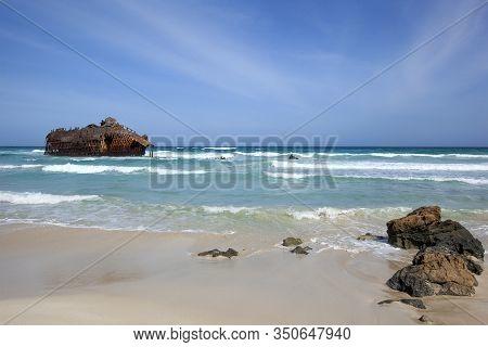 Rusty Shipwreck Near The Beach And A Blue Atlantic Ocean In Cabo Santa Maria On Boa Vista In Cape Ve