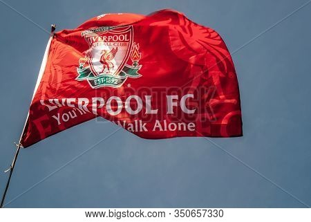 Liverpool - England - April 13, 2019: Liverpool F.c. Flag Waving With The Blue Sky Background.