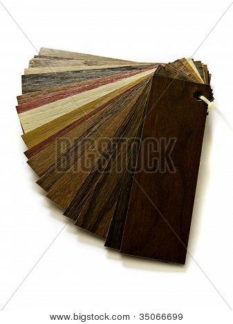 Sample Pack Of Wooden Flooring Laminate On White Background