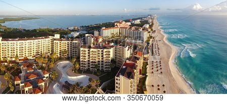 Cancun beach and The Royal Islander Resort, Hotel Emporio Cancun panorama aerial view in the morning, Cancun, Quintana Roo QR, Mexico.