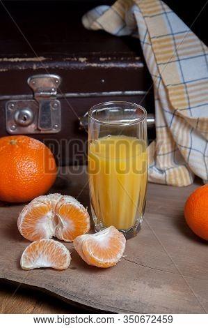 Unpeeled Round Ripe Orange Mandarins Or Tangerines, Slices Of Peeled Mandarin And Glass Of Fresh Jui
