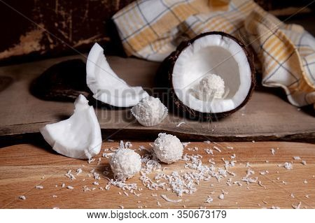 Close Up Of Coconut With White Pulp, Coconut Chip And White Candies On Wooden Background..