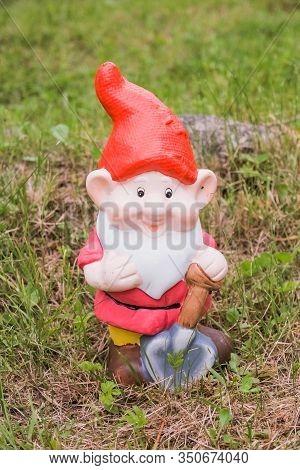 Garden Dwarf In Garden, Gnome Decoration.figure Of A Garden Gnome In The Grass.decoration Of Garden,