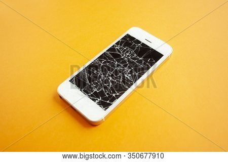 Broken Screen Of Smartphone On The Orange Background. Smashed Glass Of Cell Phone, Illustration For