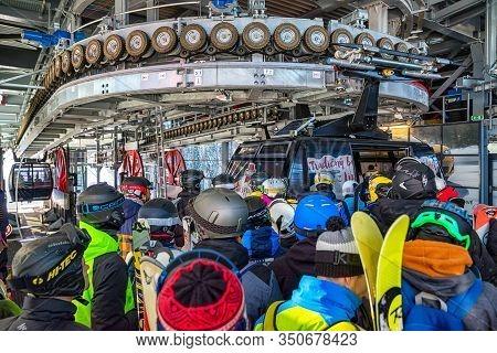 Demanovska Dolina, Slovakia - February 8: Many Skiers In Station Of Cableway Funitel In Ski Resort J
