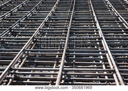 Steel Rebars For Reinforced Concrete Construction Site. Piled Iron Reinforcement Workpieces