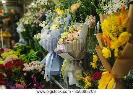 Different Varieties Fresh Spring Flowers In Refrigerator Room For Flowers. Beautiful Flowers In Cold
