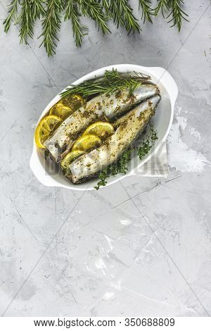 Mackerels Served On White Dish With Lemon, Thyme, Rosemary And Spices. Raw Marinated Fishes On Light