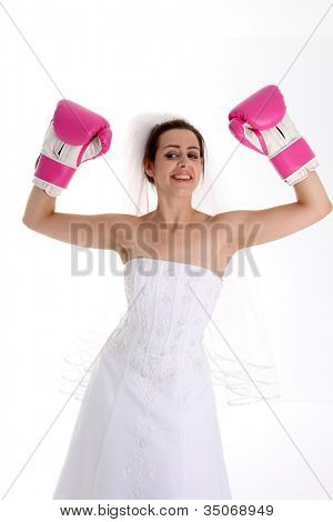 Woman in a wedding dress with boxing gloves