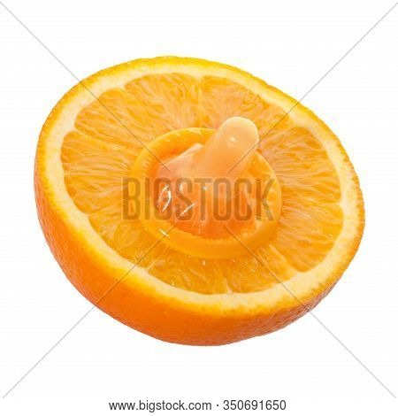 Unwrapped Color Condom With Fruit Flavor And Halved Orange Isolated On White Background. Macro Shot.