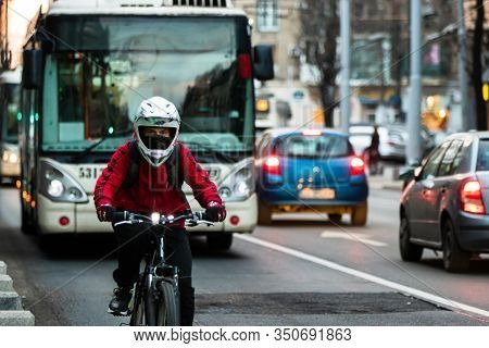 Traffic At Rush Hour In Downtown Area Of The City. Man Riding A Bike In The Morning Or Evening In Bu