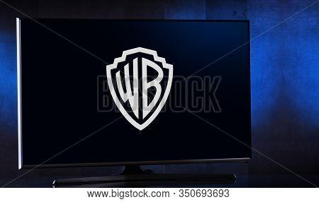 Poznan, Pol - Feb 04, 2020: Flat-screen Tv Set Displaying Logo Of Warner Bros., An American Entertai