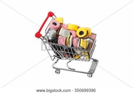 Shopping Cart Filled With Assorted English Liquorice Candy Isolated On White Background.