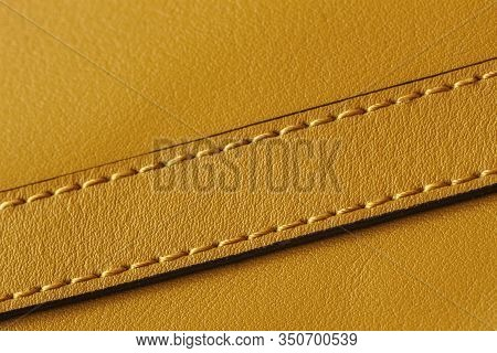 Detail Of Handbag With Stitching, Genuine Leather Of Bright Yellow Color. Texture And Fashionable Ba